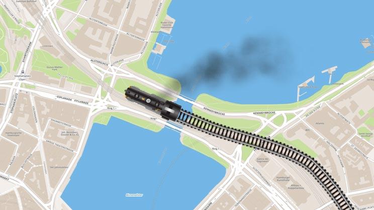 Lok mit Dampf auf Gleisen